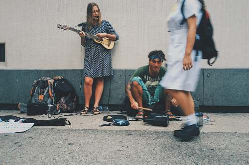 person woman playing guitar on street human