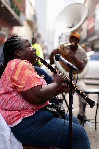 human woman using black clarinet person