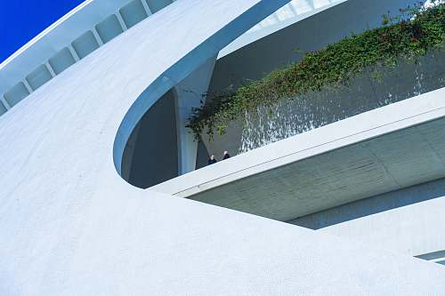 architecture high-angle photography of white rooftop building