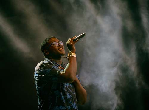 human man holding microphone singing people