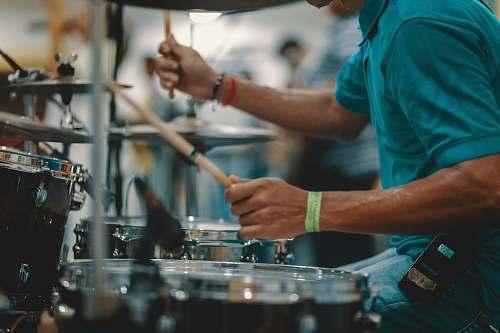 human man playing acoustic drum people