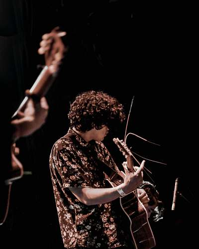 people man playing acoustic guitar human