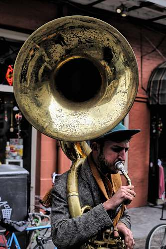 human man plying trombone people