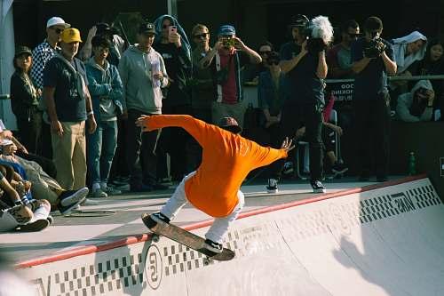 human man riding skateboard people