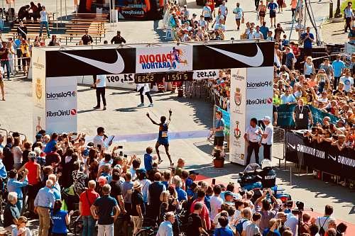 crowd people watching Padova marathon during daytime people