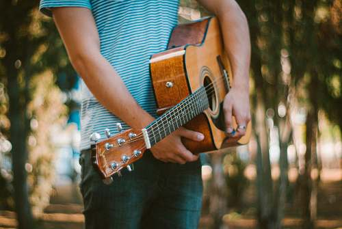 people person holding acoustic guitar human