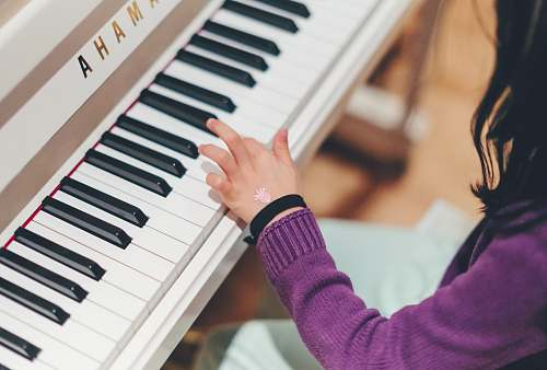 human person playing piano people