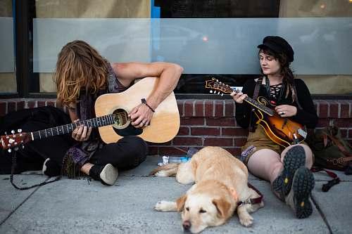 human two men playing guitars people