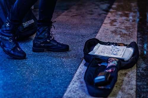 footwear two black bags on pedestrian lane clothing