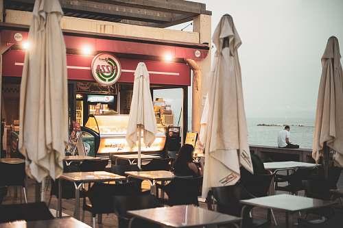 barcelona white dining tables near food establishment restaurant