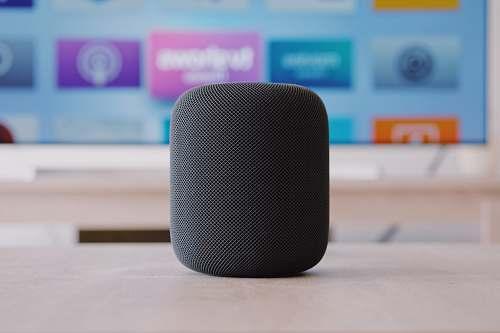 loudspeaker black Apple HomePod speaker on table electronics