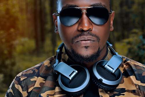 accessory man wearing sunglasses and grey and black headphones accessories
