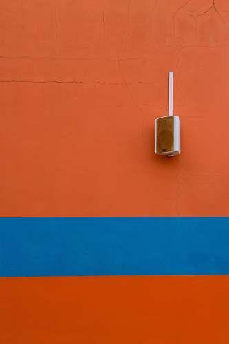 speaker white speaker mounted on orange painted wall adapter