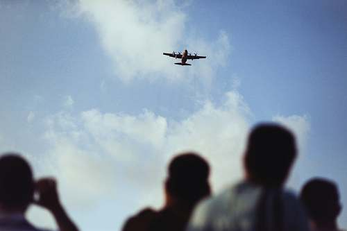 people airplane flying above the sky aircraft