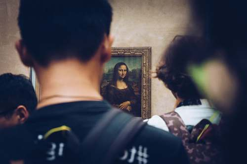 person men in front of Mona Lisa painting people
