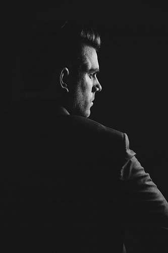 portrait grayscale photo of man wearing blazer person