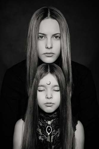 person grayscale photography of two women people
