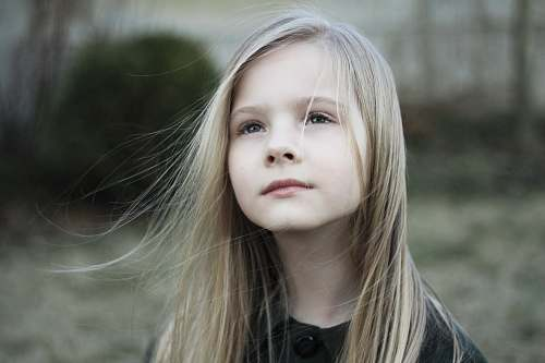 people close-up photography of girl in black top during daytime kid