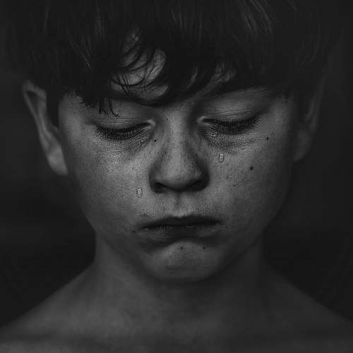 black-and-white black haired boy crying portrait
