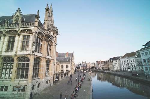 canal body of water between buildings water