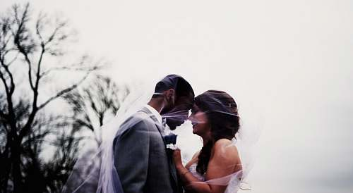 human bride and groom facing each each other photo wedding