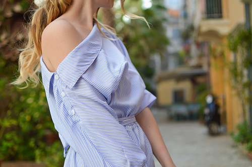 person closeup photo of woman wearing single-shoulder dress human