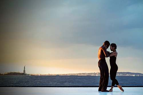 dance couple standing near body of water during daytime new york