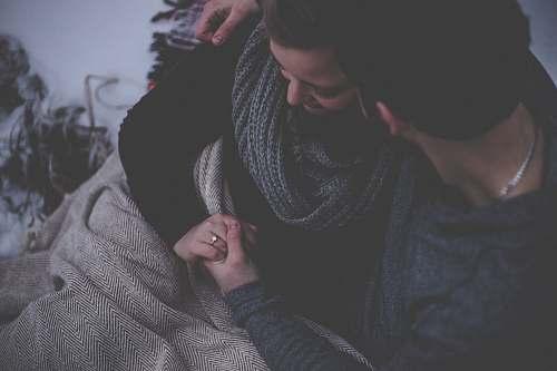 human couple with grey blanket couple