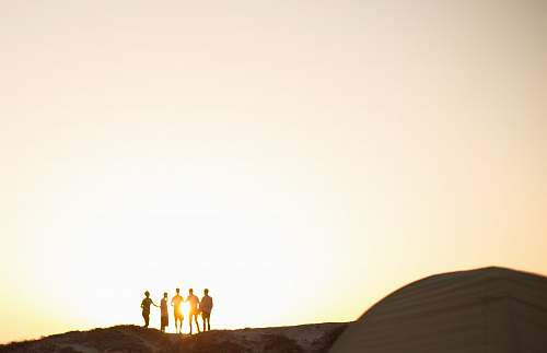 silhouette five men standing on a cliff group
