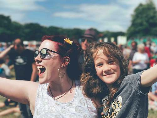 person girl and woman near people at the field during day human