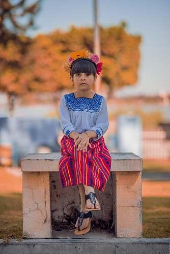 kid girl sitting on bench girl