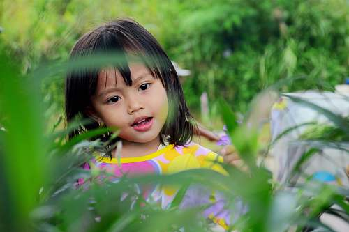 girl girl surrounded by plants leaf