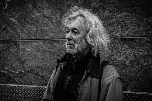 black-and-white grayscale photo of long-haired man grey