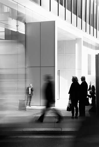 human grayscale photo of people walking towards building black-and-white