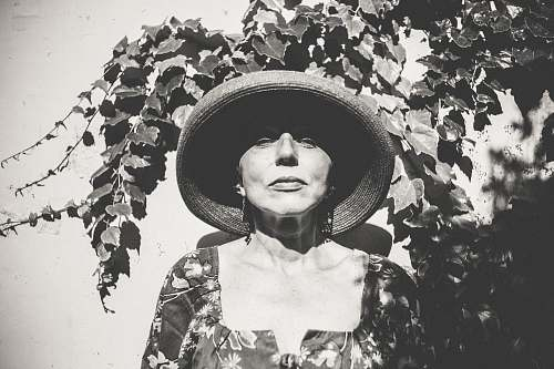 person grayscale photo of woman wearing hat hat
