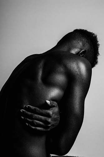 person greyscale photo of naked man black-and-white