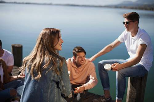person group of people sitting on boat dock human