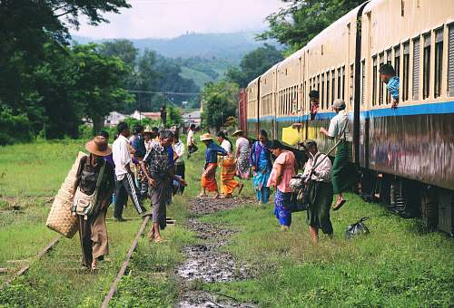 human group of people standing outside train train