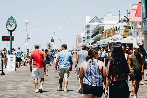 boardwalk group of people walking on street during daytime tourist