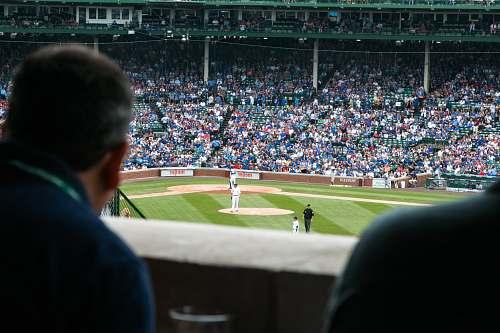 person group of people watching baseball game baseball