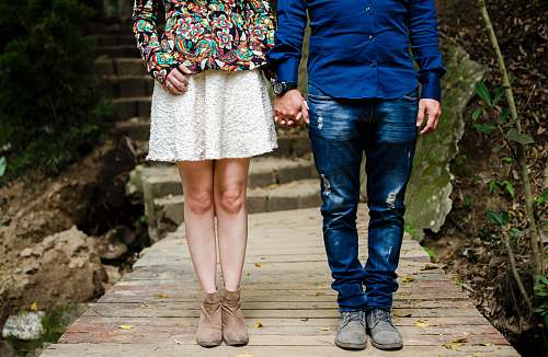 couple man and woman holding hands during daytime clothing
