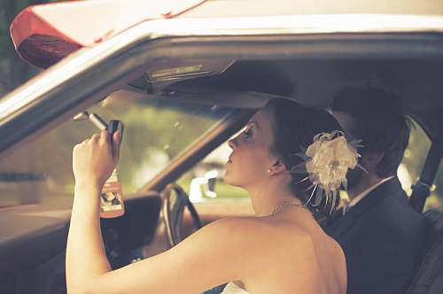 person man and woman sitting inside the vehicle wedding