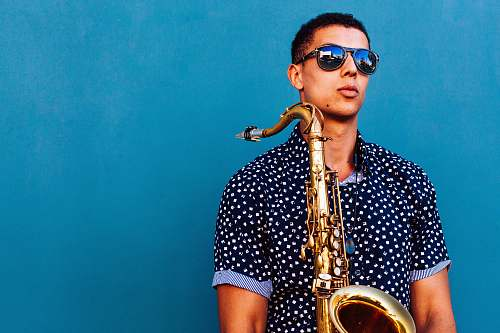 los angeles man holding saxophone instrument blue