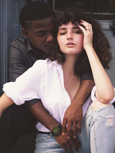 couple man hugging woman while taking photo of each other diversity