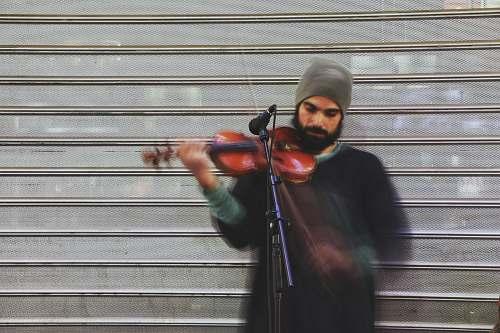 person man playing violin during daytime music