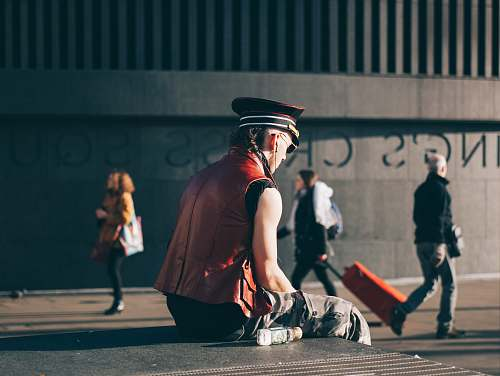 person man sitting on pavement man