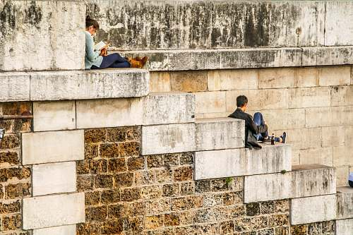 paris man sitting on staircase behind woman sitting on highest staircase france