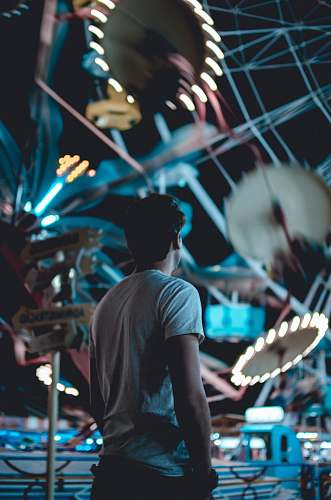 person man standing near amusement park during daytime man