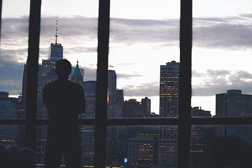 person man standing near window building