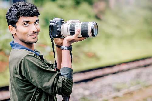 human man taking photo in selective focus photography photographer
